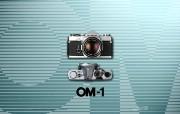 Olympus 奥林巴斯相机壁纸 70年经典 下辑 1972年的奥林巴斯相机图片 Olympus Camera OM 1 Camera 奥林巴斯70年经典相机二 广告壁纸