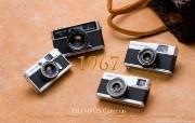 1967年的奥林巴斯古董相机 Olympus Cameras in 1962 Olympus 奥林巴斯70年经典相机壁纸上辑 广告壁纸