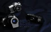 1982年的奥林巴斯古董相机 Olympus Cameras in 1982 Olympus 奥林巴斯70年经典相机壁纸上辑 广告壁纸