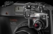 2005年的奥林巴斯数码相机 C 7070 Olympus Digital Cameras C 7070 Olympus 奥林巴斯70年经典相机壁纸上辑 广告壁纸