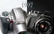 Olympus 奥林巴斯相机纪念壁纸 三 奥林巴斯单反相机 1997 Oplympus SLR Cameras Olympus 奥林巴斯相机三 广告壁纸