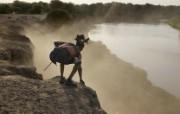 游历大千世界 kara tribe elder 黄昏中的奥莫河图片壁纸 国家地理杂志每日一图2010三月摄影壁纸 人文壁纸