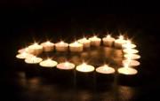 1920x1200 祝福的烛光 纪念汶川地震 1920x1200 烛光拼成心形表达祝福 1920x1200 祝福的烛光壁纸 摄影壁纸